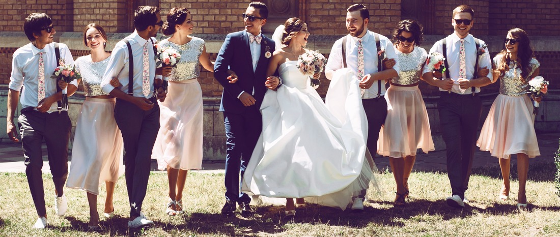 Joyful young couple and their stylish friends
